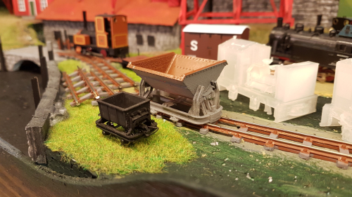 162654  -- here it clearly shows the difference in scale.. MiniTrains cement wagon left with 3D print skip to the right