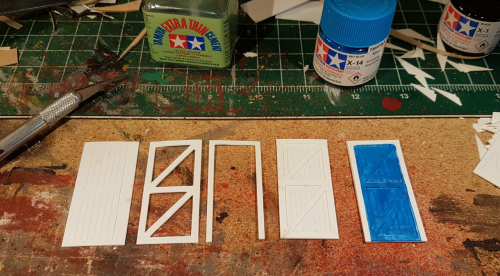 162644  -- from left the 3 pieces making a door, then assembled plus one with first paint on