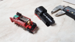 With a bit of help from friends I found out how to remove the body from a Roco TT chassis without damaging it. You bend lightly between there the buffer beam and the back of the body meets and voila, there you have it! Here is a series of photos showing..