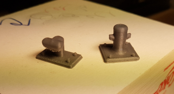 This evening I designed and printed two types of bollards. The winner was the straight up pole kind of guy .. The bent horn type is nice to, but gives hint of a much bigger harbor than I had in mind.  These will be painted flat black with a bit seagull sh